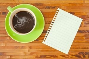 Coffee and notepad ready to start planning your marketing strategy